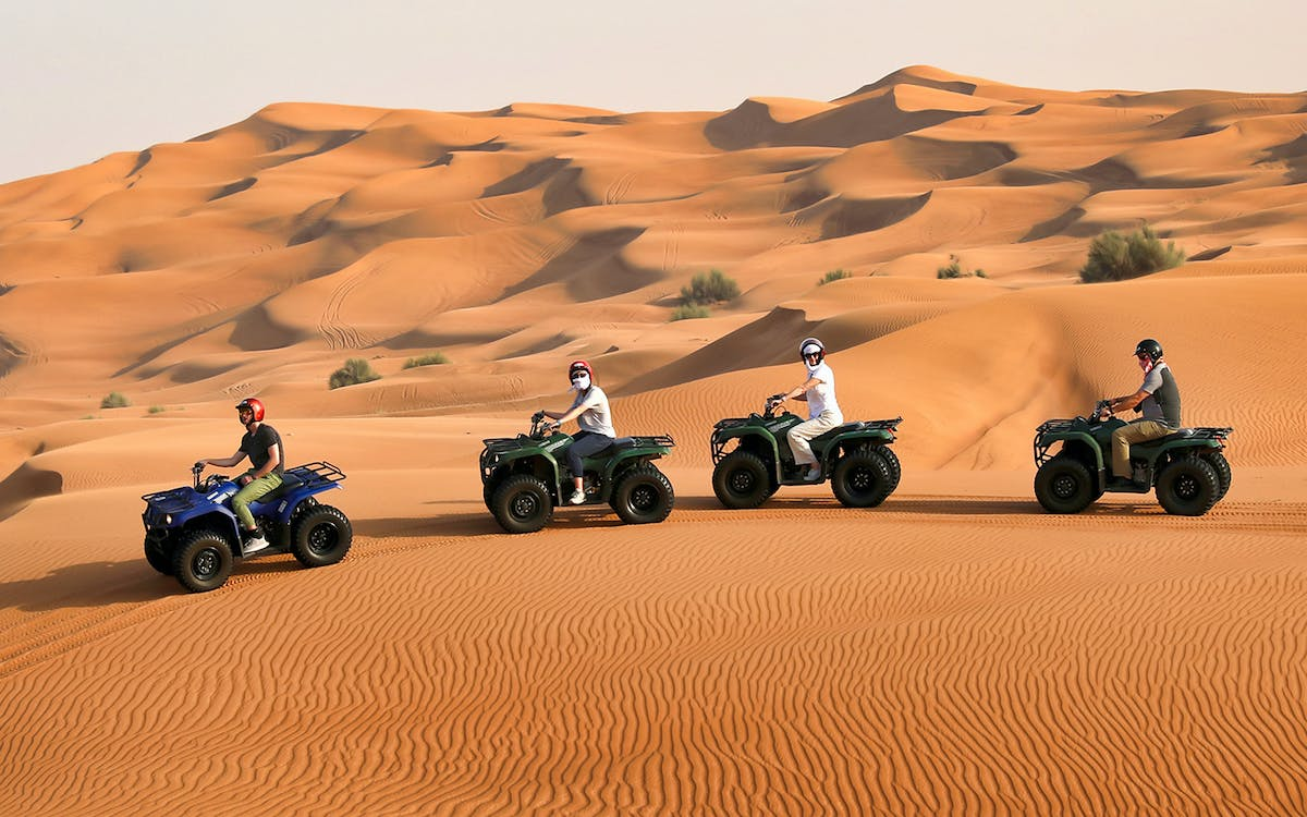 red dunes by quad bike, camel riding, sandboarding and bbq dinner at al khyama c-1
