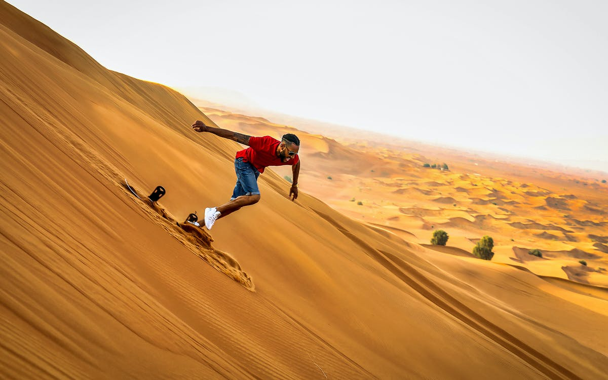 premium morning quad bike, sandboarding and camel ride-1