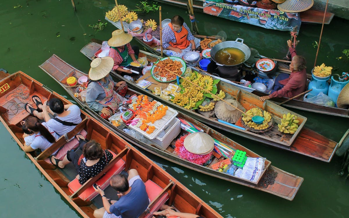 small group tour of damnoensaduak floating market & maeklong train market with t-1