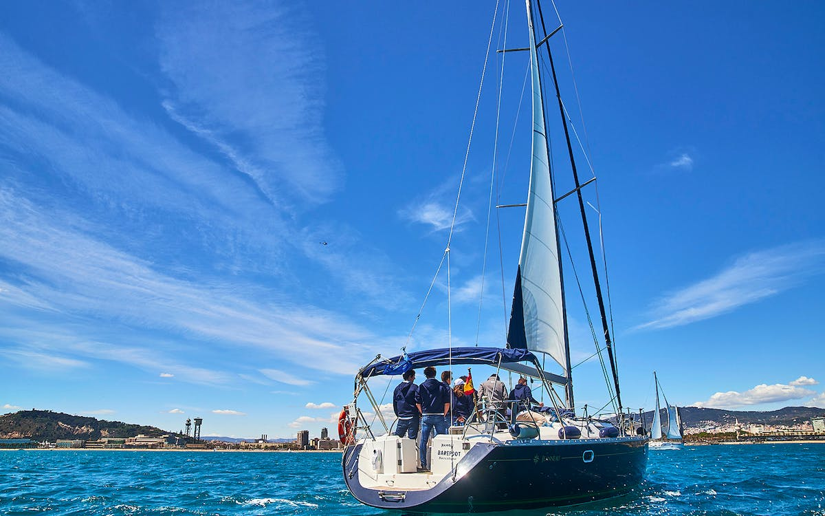sailing tour in barcelona with paddle surfing-0