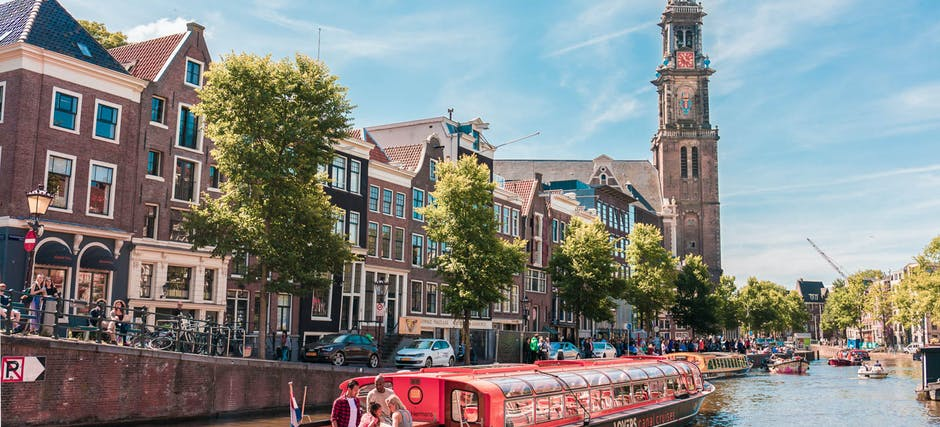 Amsterdam Guided City Tour + 1-hr Canal Cruise